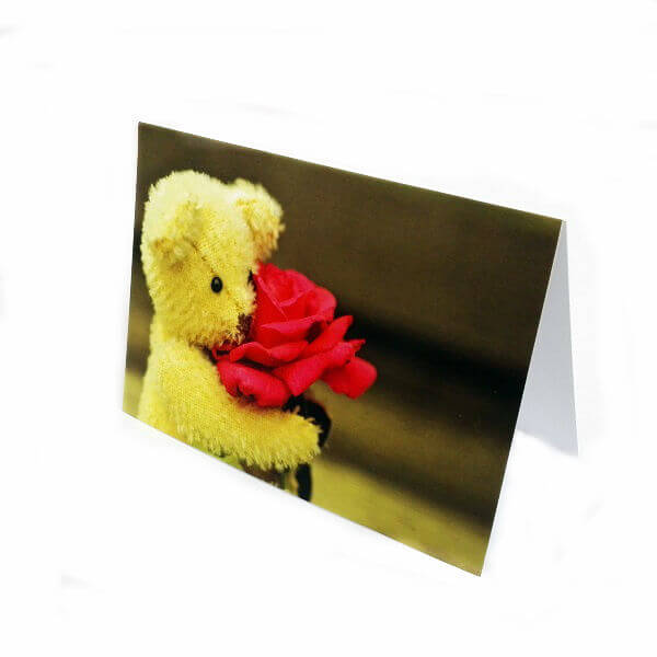 "Greeting card ""Bear with a flower"""