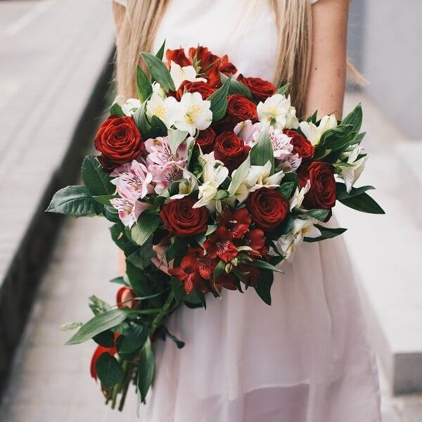 Bouquet of red roses and alstromeries