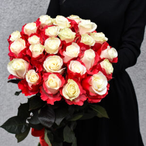 Bouquet of white roses with red petals